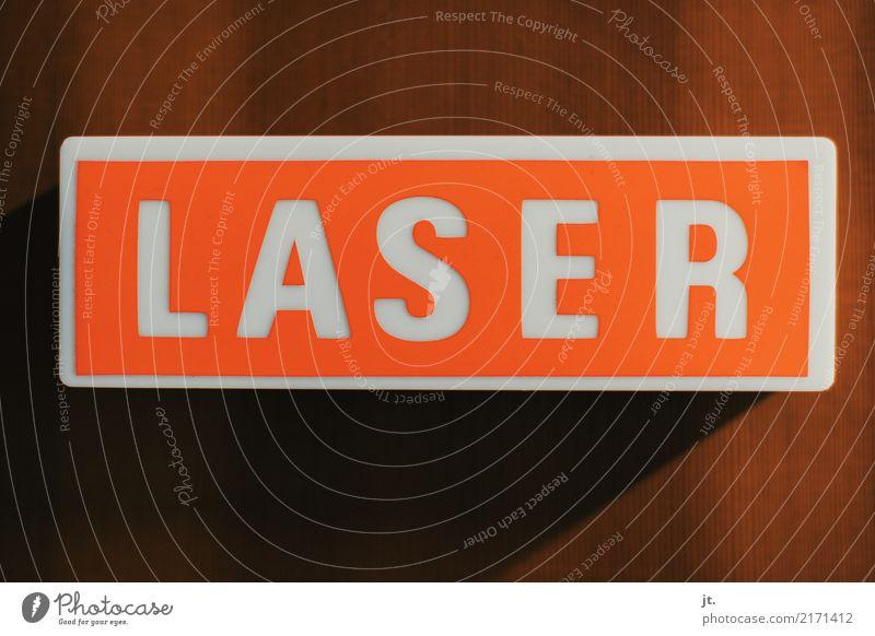 Laser-Warnleuchte Kunststoff Schriftzeichen Hinweisschild Warnschild alt retro braun orange weiß Sicherheit gefährlich Gesundheitswesen Zukunft Farbfoto