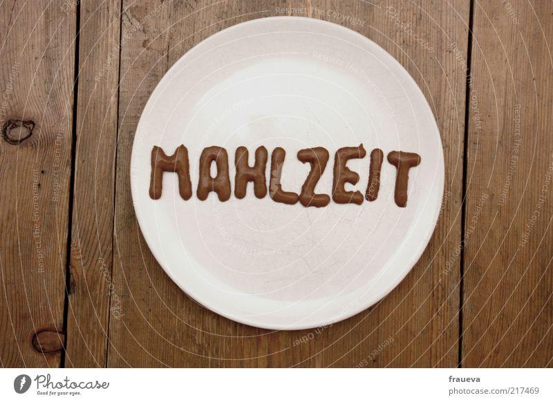 aufessen sonst wird das wetter schlecht Lebensmittel Süßwaren Ernährung Mittagessen Teller Buchstaben Holztisch Farbfoto Gedeckte Farben Innenaufnahme Tag