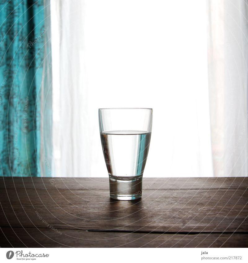 wasser Getränk Trinkwasser Glas Gesundheit Häusliches Leben Tisch Holz Flüssigkeit blau braun weiß rein Farbfoto Innenaufnahme Menschenleer Textfreiraum oben