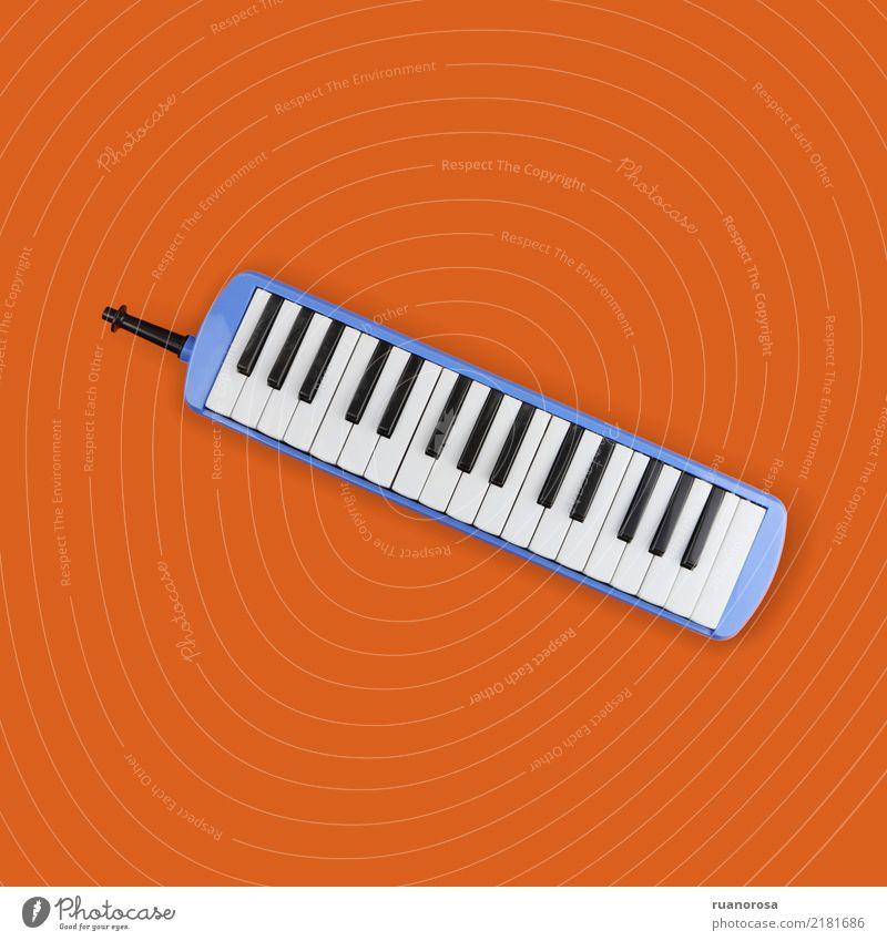 Einsames Objekt Nr. 3 Musik Keyboard Coolness Originalität blau orange Farbfoto mehrfarbig Innenaufnahme Studioaufnahme Nahaufnahme Menschenleer
