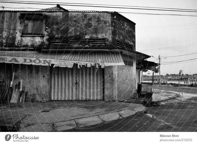 A Don. alt Ferien & Urlaub & Reisen Haus Wand Mauer Gebäude Architektur Tür Armut Fassade authentisch kaputt Asien einzigartig gruselig verfallen