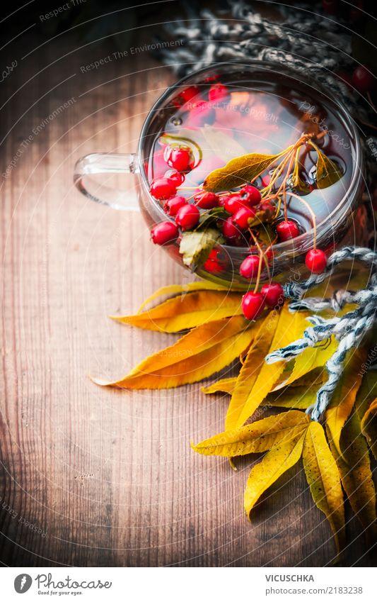 Tasse mit Herbst Tee und Weißdorn Getränk Heißgetränk Lifestyle Design Gesundheit Gesunde Ernährung Leben Häusliches Leben retro gelb Stil Hintergrundbild