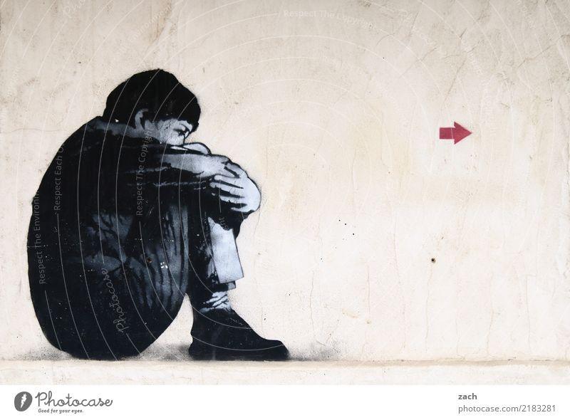 richtungsweisend Mensch Frau Erwachsene Mauer Wand Fassade Schilder & Markierungen Graffiti Pfeil sitzen Traurigkeit grau Trauer Müdigkeit Enttäuschung
