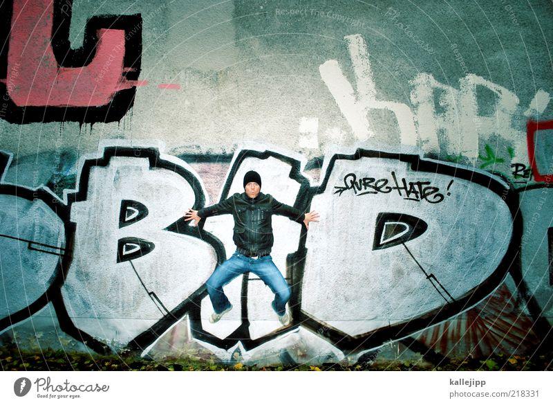 who´s bad? Mensch Mann Erwachsene Leben Wand Graffiti springen Mauer Tanzen Schriftzeichen Kultur Jeanshose Jacke Mütze böse Leder