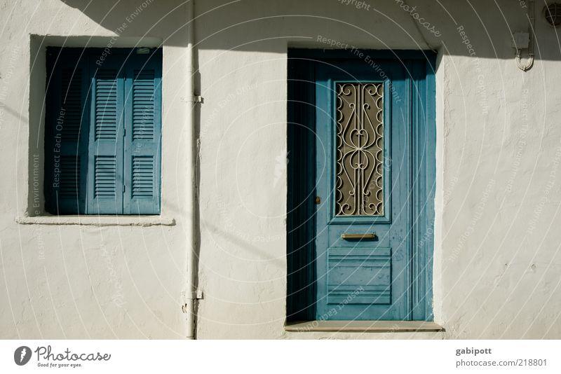 Tür neu weiß blau Sommer Ferien & Urlaub & Reisen Ferne Wand Fenster Mauer Gebäude Architektur Fassade geschlossen Tourismus Reisefotografie Originalität