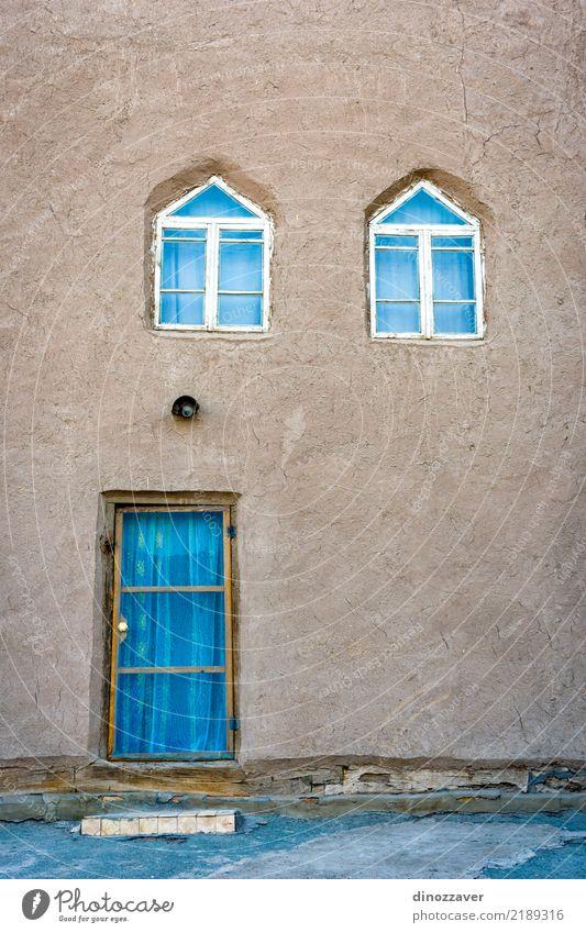Schlammhaus in der Innenstadt von Chiwa Ferien & Urlaub & Reisen alt Farbe Architektur Religion & Glaube Holz Gebäude Kunst Tourismus Fassade Design