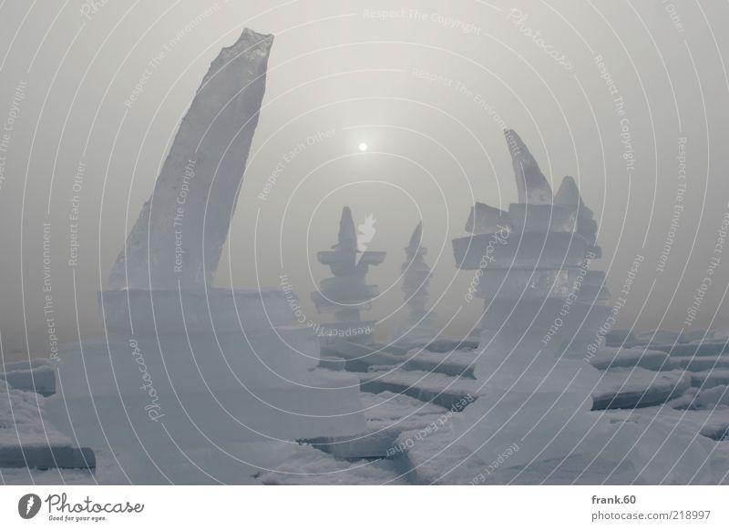 Eissäulen Natur Wasser Himmel Sonnenlicht Winter Nebel Frost frieren außergewöhnlich eckig fantastisch fest groß kalt nass schön stark weiß Einsamkeit Farbfoto