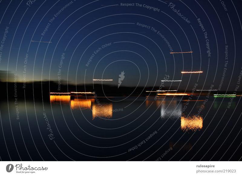 moving lights Natur Wasser Meer blau Sommer ruhig schwarz dunkel Küste Horizont Insel Hafen Nachthimmel Bucht Ostsee