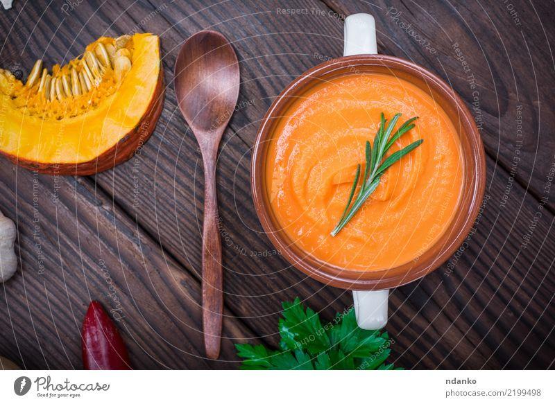 Kürbiscremesuppe Gesunde Ernährung grün Essen gelb Herbst Holz braun oben frisch Tisch Kräuter & Gewürze Gemüse Jahreszeiten Schalen & Schüsseln Abendessen Diät