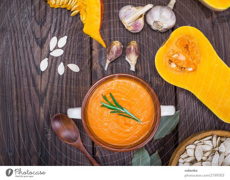 Kürbissuppe in einer keramischen Platte Essen gelb Herbst Holz Gesundheitswesen braun oben frisch Tisch Gemüse Jahreszeiten Bioprodukte Schalen & Schüsseln