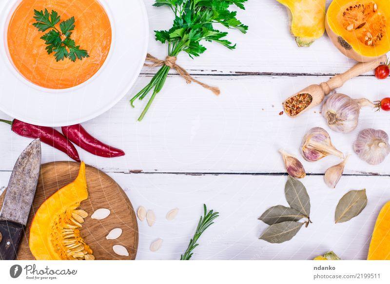 Kürbiscremesuppe Gesunde Ernährung grün weiß rot Essen gelb Herbst Holz Gesundheitswesen Dekoration & Verzierung frisch Tisch Kräuter & Gewürze Gemüse