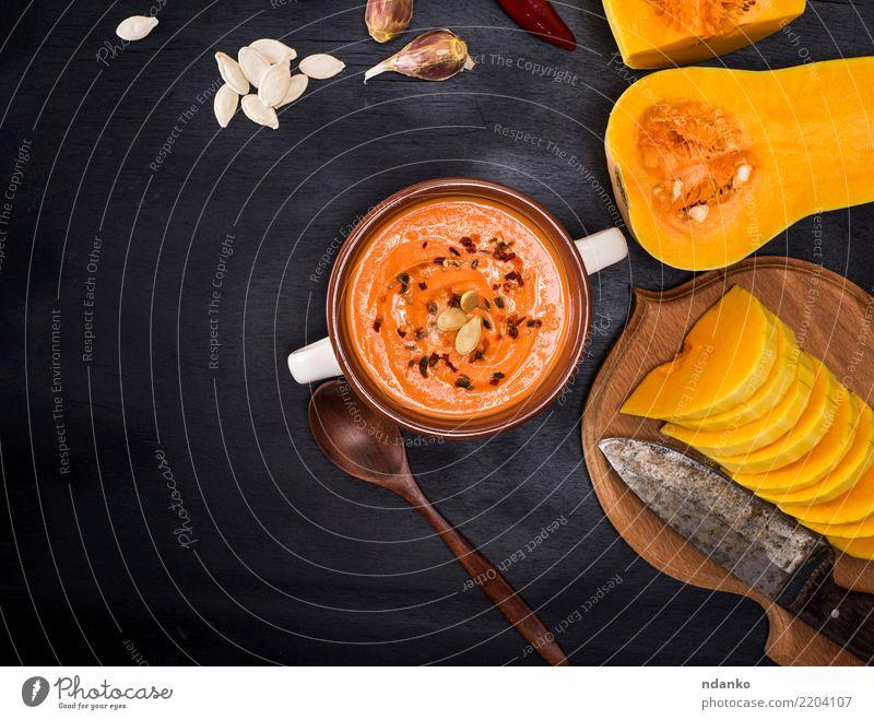 Sahne frische Kürbissuppe Natur Speise Essen gelb Herbst Holz Dekoration & Verzierung Tisch Kräuter & Gewürze Gemüse Jahreszeiten Ernte heiß Bioprodukte