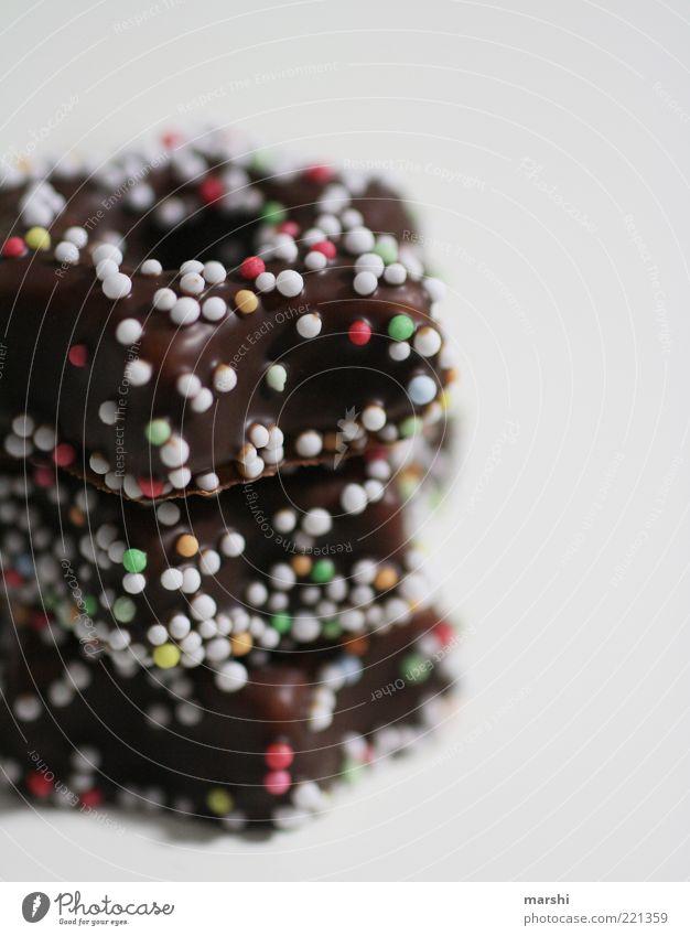 Pünktchen auf Schokolade Süßwaren Ernährung lecker braun mehrfarbig Punkt Stapel Unschärfe ungesund Appetit & Hunger Farbfoto Innenaufnahme Streusel