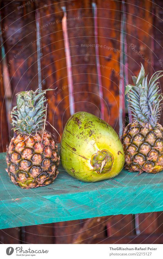 Pinacolada Ananas braun gelb grün türkis Pina Colada Kokosnuss Getränk lecker Frucht Südfrüchte ausstellen Farbfoto Außenaufnahme Detailaufnahme Menschenleer