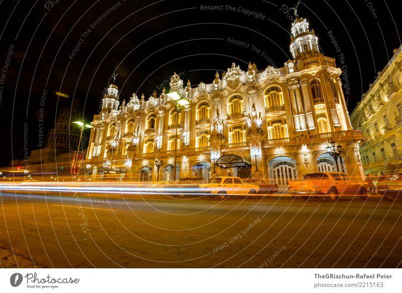 Havanna by night Stadt Hauptstadt Haus alt ästhetisch Orange gelb Oldtimer Straßenbeleuchtung Lichterscheinung Bewegungsunschärfe Langzeitbelichtung Gebäude