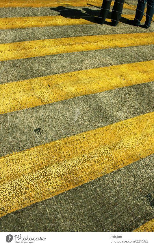 In an infinite World |Why don't we stop here? Beine Verkehrswege Fußgänger stehen warten bedrohlich trist Zebrastreifen gelb Straßenbelag Asphalt Farbe
