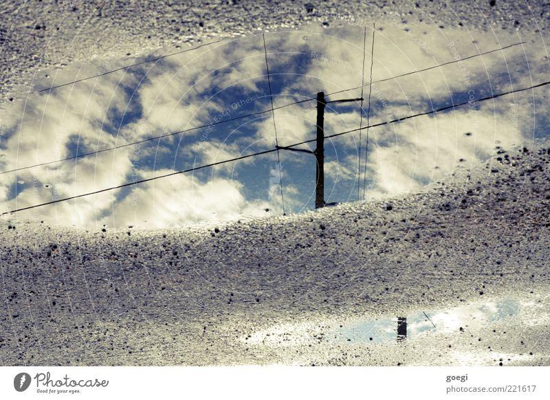 puddle of clouds Wasser Himmel Wolken blau grau schwarz weiß Strommast Hochspannungsleitung Telefonmast Telefonleitung Pfütze Farbfoto Außenaufnahme