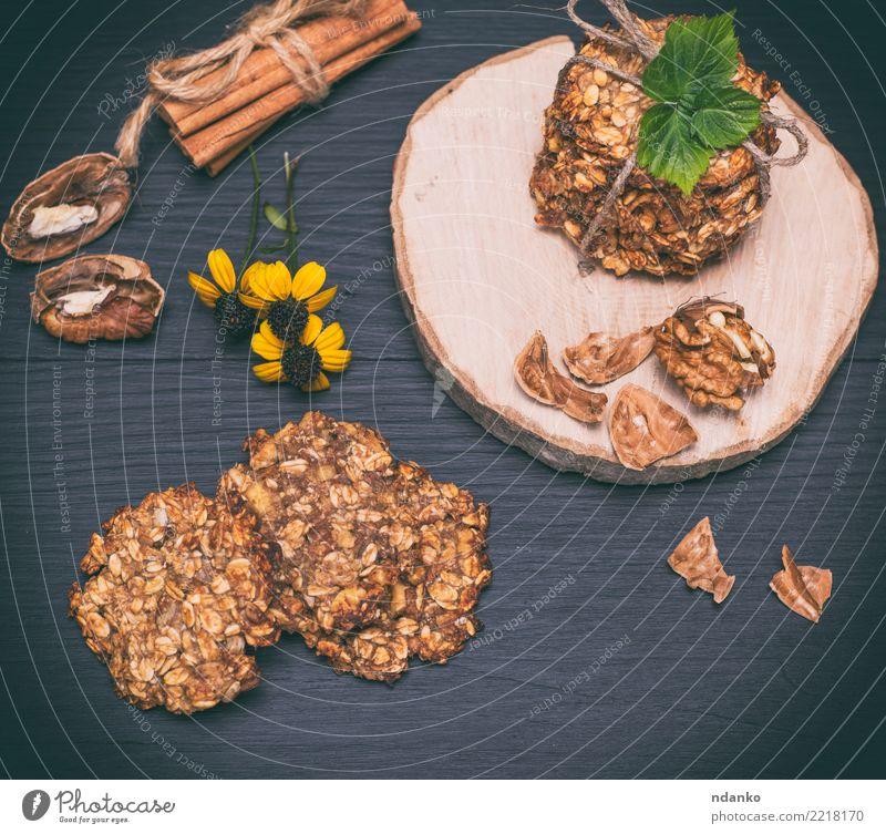 hausgemachte Haferkekse Dessert Ernährung Frühstück Mittagessen Diät Kakao Tisch Blume Blatt Holz Essen lecker natürlich braun gelb schwarz Energie Tradition