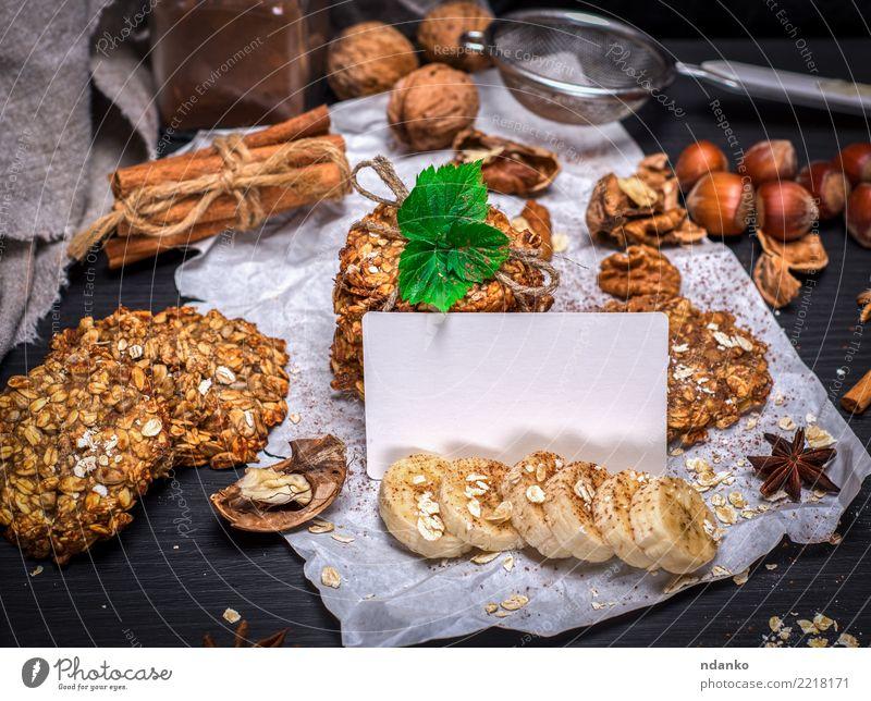 Ookies aus Haferflocken Dessert Ernährung Frühstück Mittagessen Diät Kakao Holz braun gelb schwarz weiß Energie Tradition Attrappe Postkarte leer Vorlage