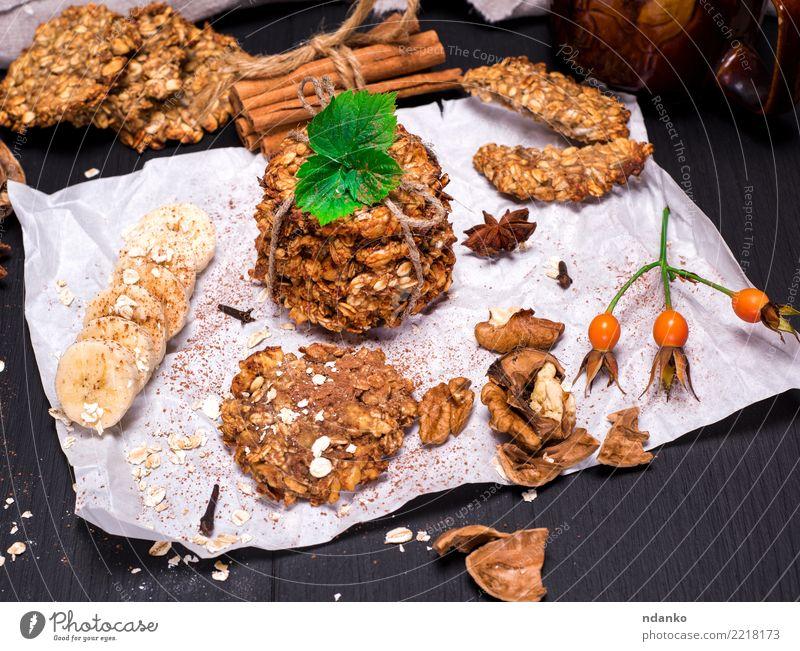 Kekse aus Haferflocken und Bananen Dessert Süßwaren Ernährung Frühstück Mittagessen Vegetarische Ernährung Diät Kakao Tisch Holz Essen lecker natürlich braun