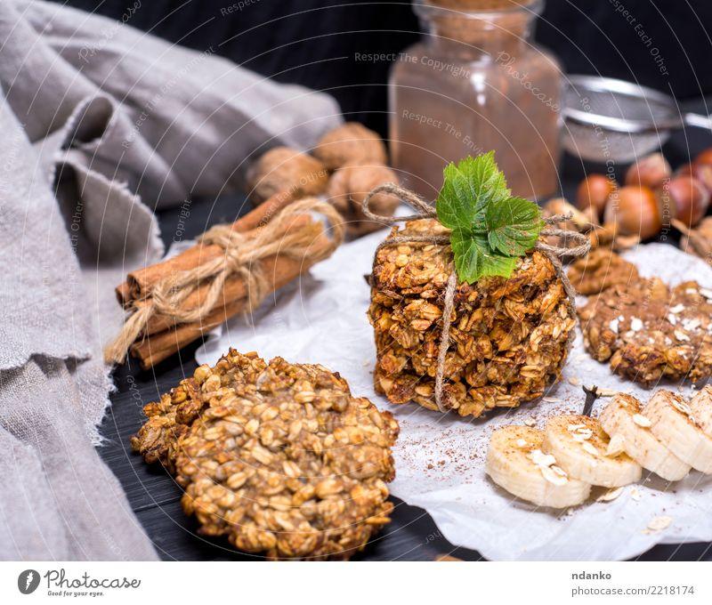 runde Kekse aus Haferflocken Dessert Süßwaren Ernährung Frühstück Mittagessen Vegetarische Ernährung Diät Kakao Tisch Holz Essen lecker natürlich braun weiß