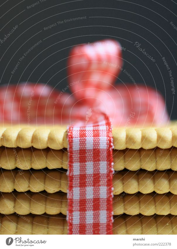 süßes Paket Lebensmittel Dessert Süßwaren Ernährung gold rot weiß Keks Butterkeks Schleife Geschenk Verpackung Unschärfe Strukturen & Formen lecker schenken