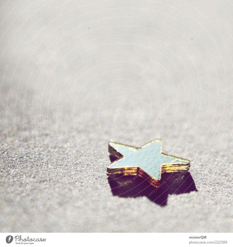 Lonely Star. Kunst glänzend Design liegen ästhetisch Stern (Symbol) Dekoration & Verzierung Kitsch Dezember Weihnachtsdekoration dezent Weihnachtsstern abstrakt Gegenlicht Krimskrams