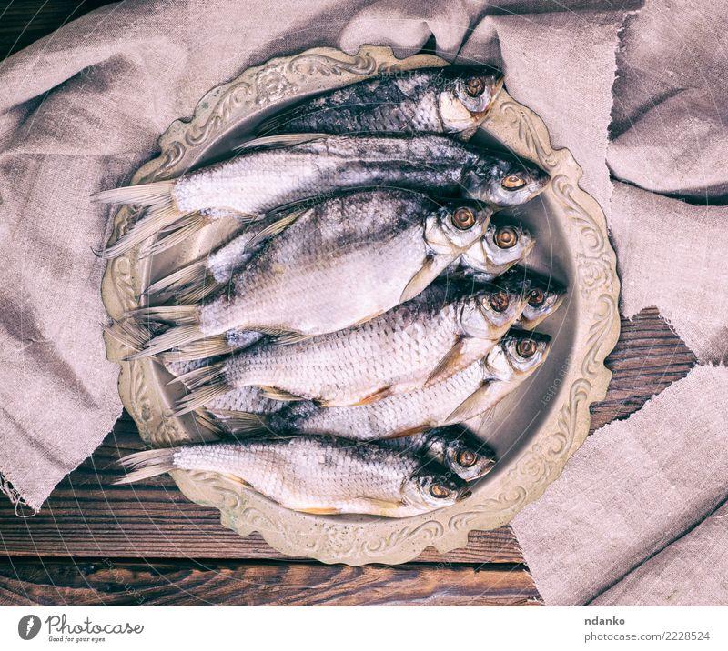getrockneter gesalzener Fisch Widder Meeresfrüchte Teller Menschengruppe Natur Tier Holz Essen natürlich oben braun grau Rotauge Hintergrund Lebensmittel