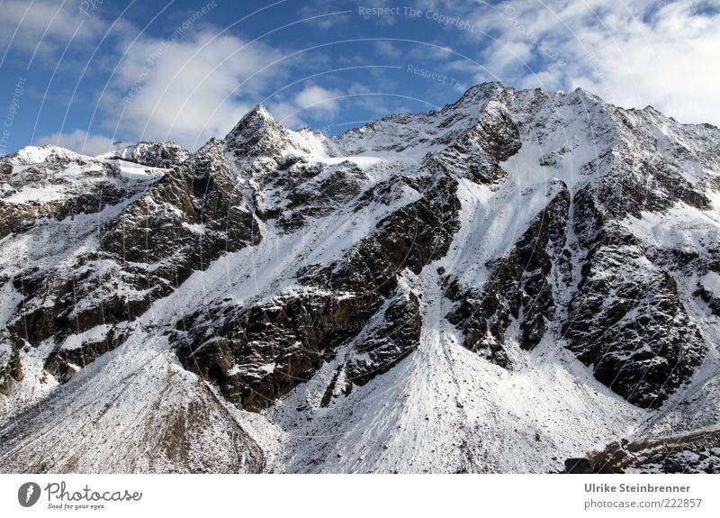 Gipfellage Himmel weiß blau Wolken schwarz kalt Schnee Herbst Berge u. Gebirge Landschaft Eis Felsen groß hoch ästhetisch Frost