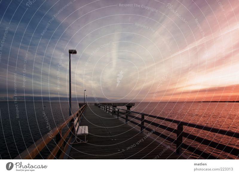 morning has broken Luft Wasser Himmel Horizont Winter Meer Holz blau rot ruhig Seebrücke mehrfarbig Außenaufnahme Morgendämmerung Schatten Kontrast Sonnenlicht