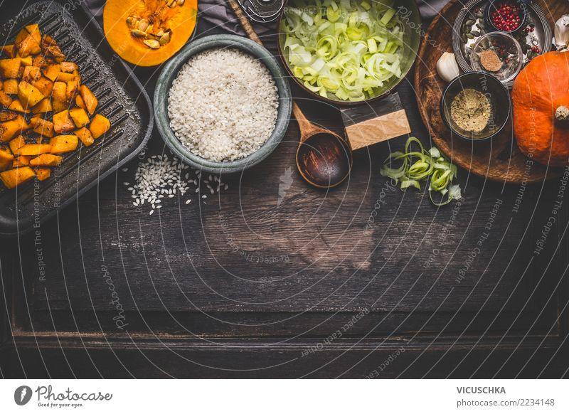 Zutaten für Kürbis Risotto Gesunde Ernährung Speise Foodfotografie gelb Hintergrundbild Herbst Lebensmittel Stil Design Tisch Küche Gemüse Bioprodukte Geschirr