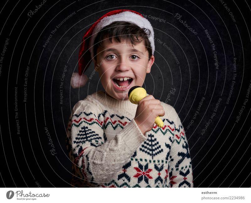 Kind, das Weihnachtslied an Weihnachten singt Lifestyle Freude Party Veranstaltung Musik Feste & Feiern Weihnachten & Advent Silvester u. Neujahr Mensch