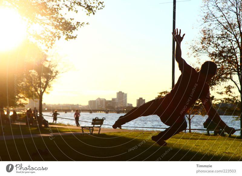 Boston slackliner Mensch Stadt Ferien & Urlaub & Reisen Sonne gelb Erholung Leben Park Zufriedenheit maskulin frisch Idylle Konzentration Skyline Lebensfreude