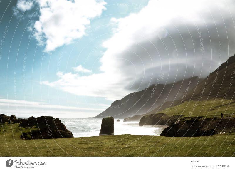 Überlichtung Himmel Natur Meer Ferien & Urlaub & Reisen Wolken Wiese Berge u. Gebirge Landschaft Umwelt Küste Wetter Felsen Klima Reisefotografie fantastisch Island