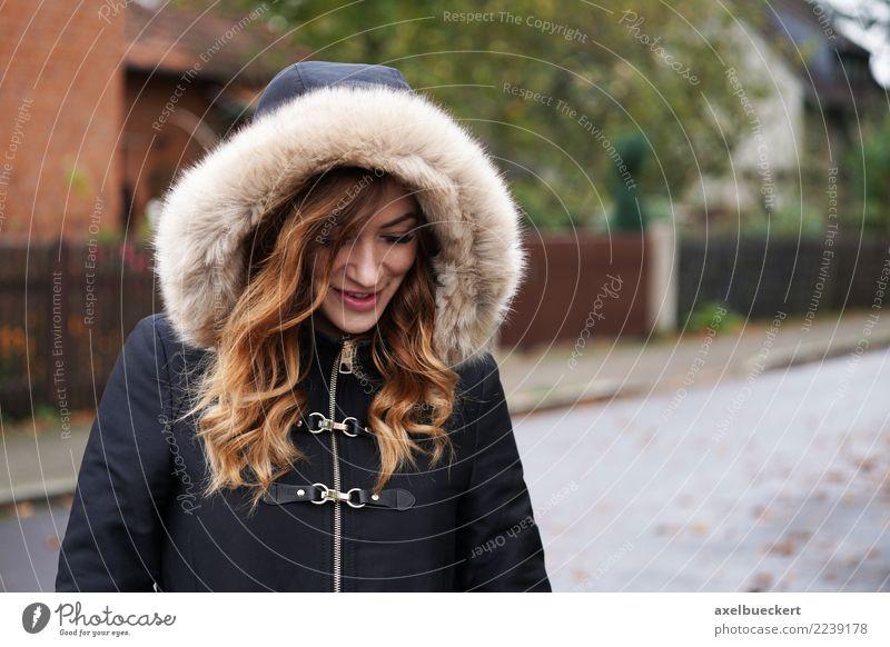 young woman wearing hooded winter coat playing coy Lifestyle Winter Mensch feminin Junge Frau Jugendliche Erwachsene 1 18-30 Jahre Dorf Stadt Stadtrand Straße
