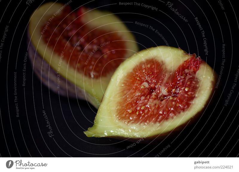 Die Versuchung Lebensmittel Frucht Feige Ernährung exotisch lecker saftig rot einzigartig rein Fruchtfleisch fruchtig Klebrig Innenaufnahme Nahaufnahme