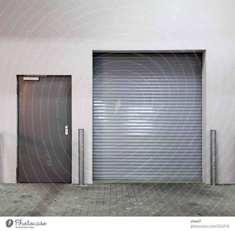 grau in grau in mausgrau Wand grau Architektur Mauer Metall Tür Fassade geschlossen Design Ordnung ästhetisch modern authentisch Güterverkehr & Logistik einfach