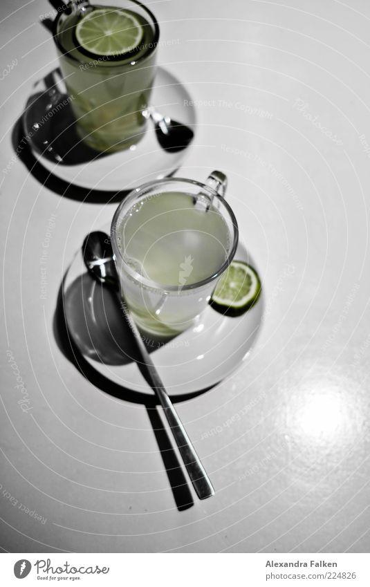 Vitamin C. Lebensmittel Frucht Limone Ingwer Ernährung Slowfood Fasten Getränk Heißgetränk Tasse Glas Löffel Untertasse heiß Heilfasten Gesundheit Ingwertee