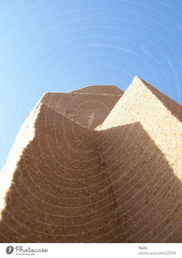 Sandwände Sonne Meer Strand Wand Sand Architektur Ecke Spitze vertikal Sandburg Schlagschatten