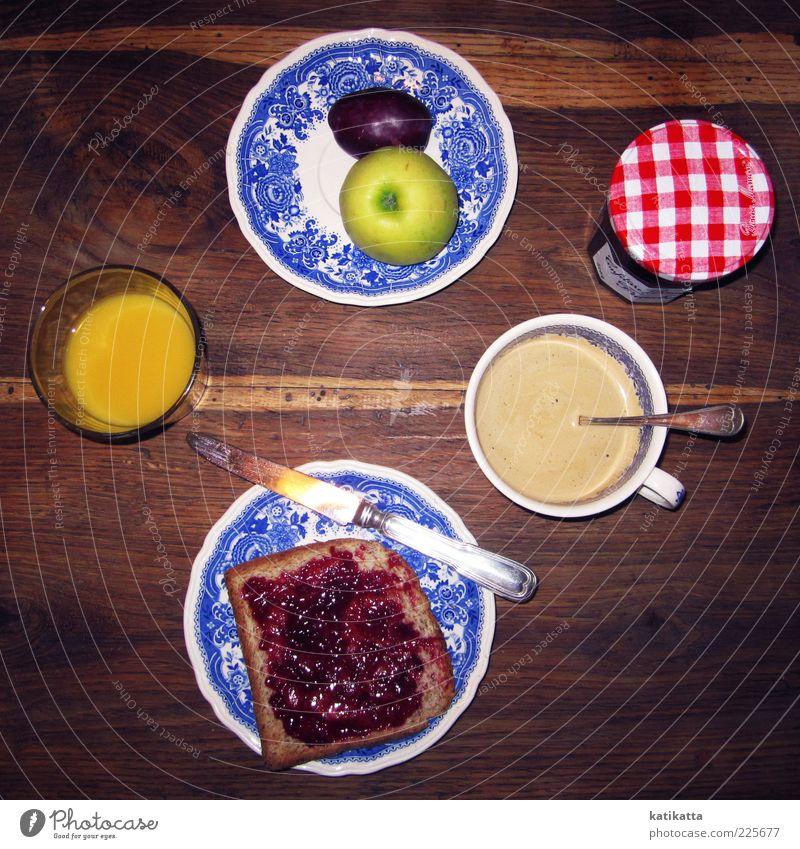 Le petit déjeuner Lebensmittel Frucht Apfel Getreide Marmelade Frühstück Kaffeetrinken Getränk Heißgetränk Saft Geschirr Teller Tasse Glas Besteck Messer Tisch