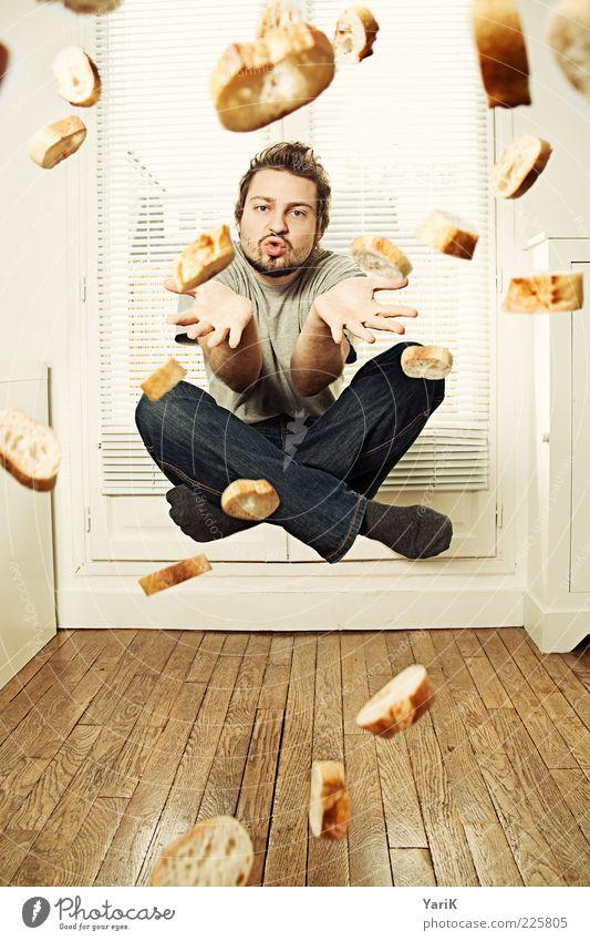 franzmann Wohnung Raum maskulin Junger Mann Jugendliche Erwachsene 1 Mensch 18-30 Jahre fliegen Baguette Brot Weißbrot Brötchen Schweben Schneidersitz werfen