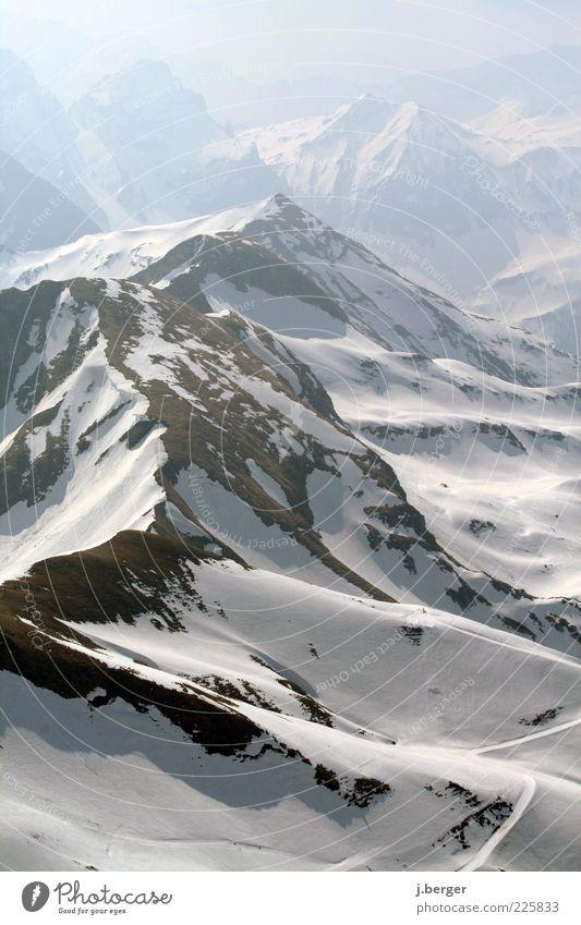 holadriö Natur blau weiß schön Ferien & Urlaub & Reisen Winter Ferne Landschaft Schnee Berge u. Gebirge Freiheit hell Eis braun Felsen Nebel