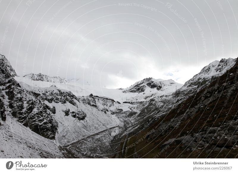 Gletscherende Wolken Ferne Straße kalt dunkel Schnee Herbst Berge u. Gebirge Stein Eis Felsen hoch gefährlich bedrohlich Alpen Gipfel