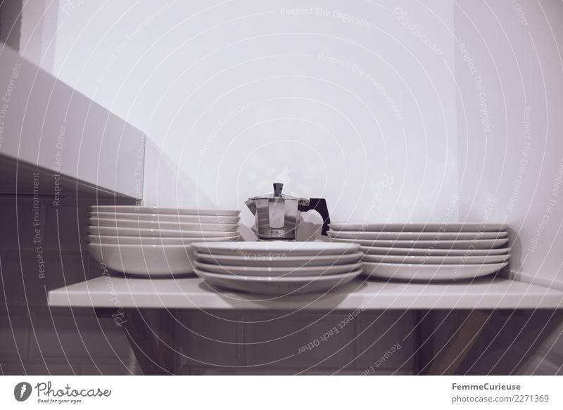Espresso maker and plates in kitchen shelf Geschirr Teller Ordnung Espressokocher Regal Küche Küchenregal weiß Wand Farbfoto Innenaufnahme Textfreiraum rechts