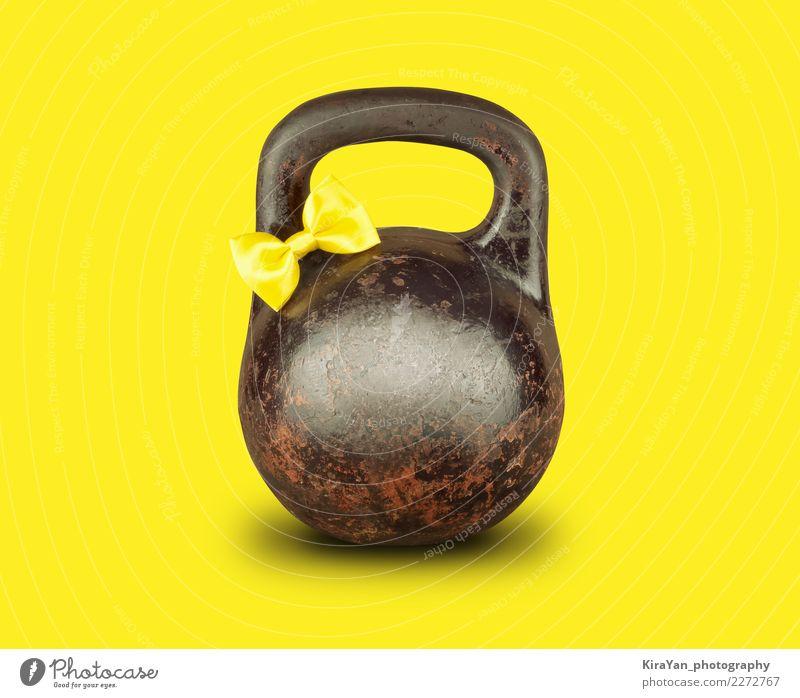 Altes kettlebell mit Gelb band Bogen auf gelbem Hintergrund Sport Gesundheitswesen Geburtstag Energie Fitness Ostern Postkarte sportlich Karneval Sport-Training
