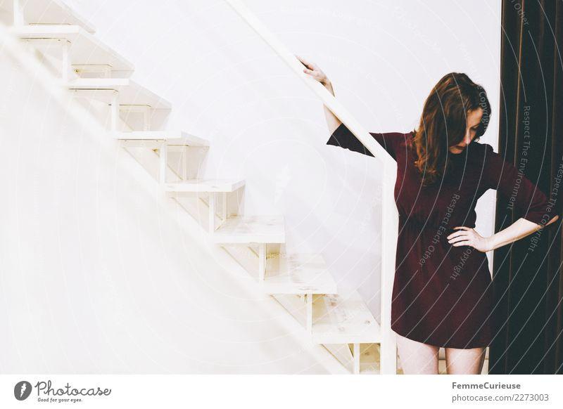 Woman in burgundy dress standing right on stairs feminin Junge Frau Jugendliche Erwachsene 1 Mensch 18-30 Jahre Gefühle Krise Schmerz In sich gekehrt