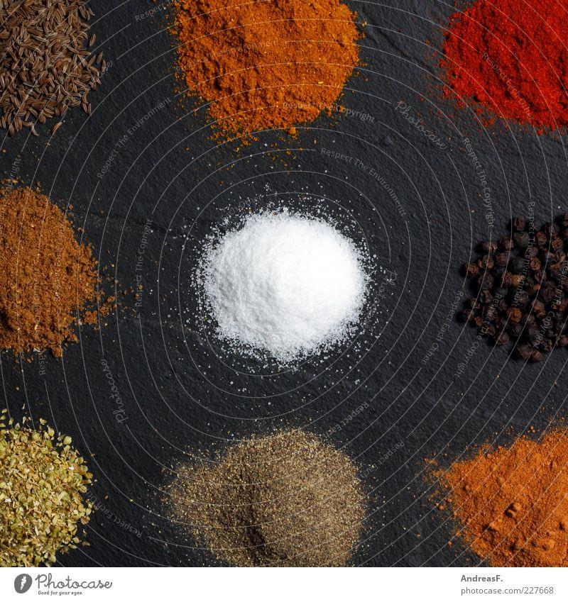 Curry & co. Lebensmittel Kräuter & Gewürze Ernährung Bioprodukte Asiatische Küche Koch Natur Stein mehrfarbig gelb rot Kümmel Paprika Pulver gemahlen