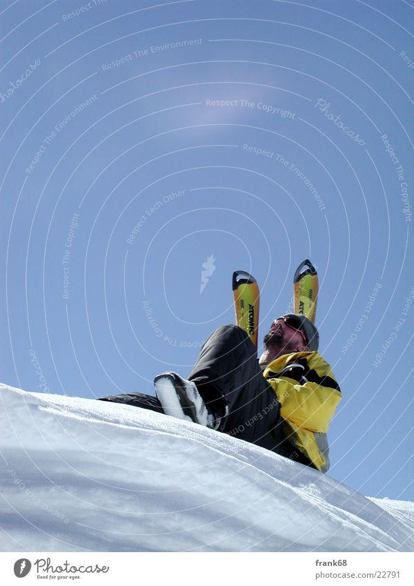 Sonne genießen Winter Skifahren Mann Schnee Freiheit