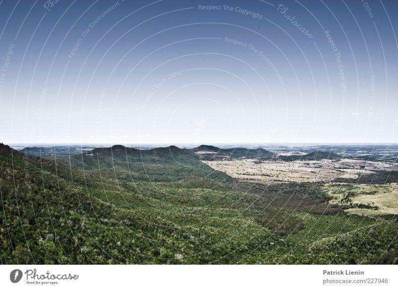 far behind Umwelt Natur Landschaft Urelemente Luft Himmel Wolkenloser Himmel Klima Wetter Schönes Wetter Wald Urwald Hügel Berge u. Gebirge natürlich wild blau