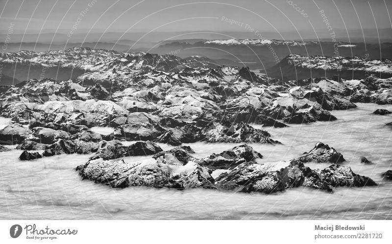 Luftbild des Anden-Gebirgszugs, Chile. Himmel Natur Ferien & Urlaub & Reisen weiß Landschaft Wolken Winter Berge u. Gebirge schwarz Umwelt Schnee oben Ausflug